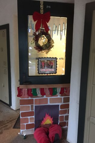 'Tis the season: Upper School advisements spread Christmas cheer through festive door decorations