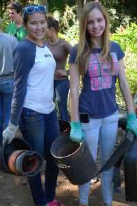 Seniors Celia Boone and Carly O'Donnell collect unused planting containers at the Kihel Gardens and Landscaping Company in Wailuku.