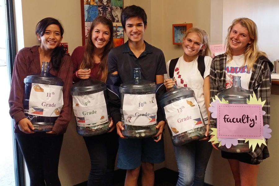 Upper school student government officers ( Alexis Smith, Kamryn Vorfeld, Jacob-Alabab-Moser, Lucia Simon, and Emma Walker) proudly show the results of their fundraiser to benefit the people affected by Typhoon Haiyan.