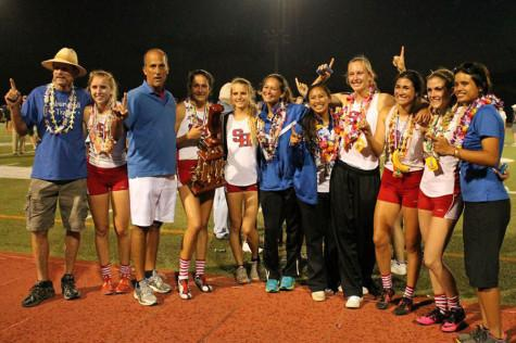 The Seabury Hall girls track and field team celebrates their first place victory at the 2014 Island Movers Hawaii State Track and Field Championships.
