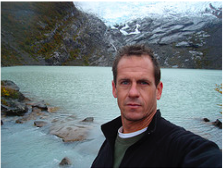 Seabury Hall Spanish teacher Richard Bailey shares stories about his travels around the world with his students.  In this photo, taken approximately eight years ago, Bailey stands in front of a glacial lake in South America.