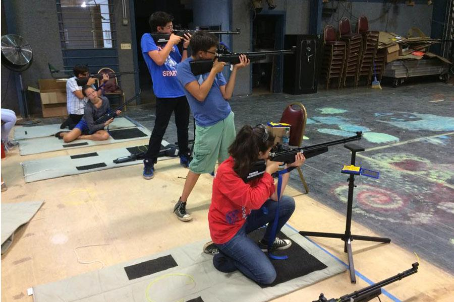 Students from Seabury Hall's inaugural air riflery team practice in the Performing Arts Studio.