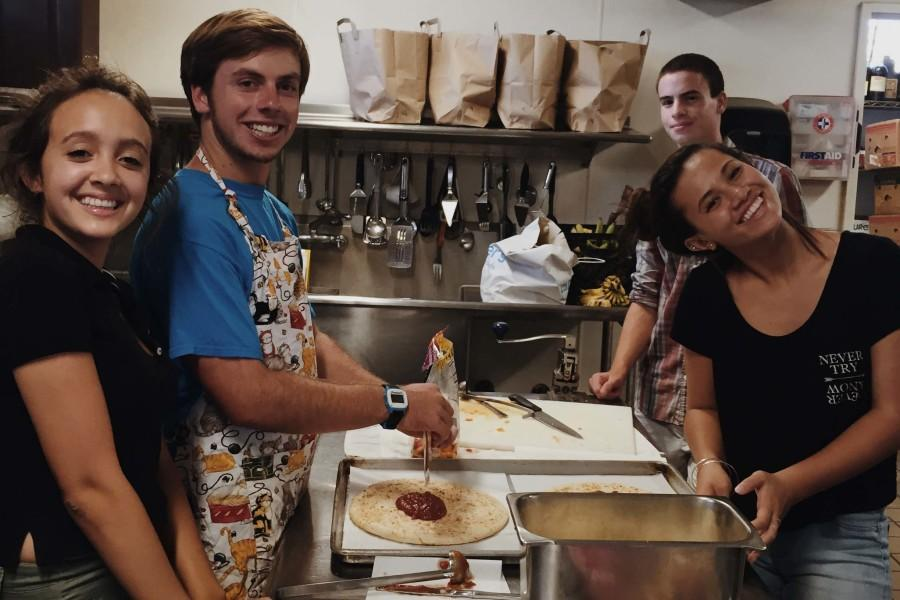 Seabury Hall students Sabrina Hansen, Juston Nees, Jonah Adelman, and Tia Hill prepare pizzas to be served for dinner on Friday, September 11 at the Ka Hale A Ke Ola Homeless Resource Center in Wailuku.