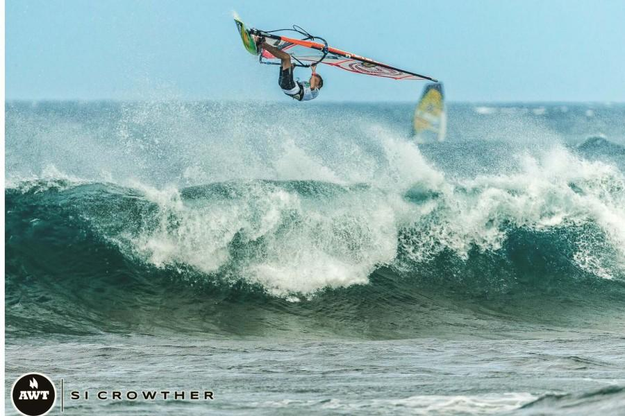 Seabury Hall freshman Jake Schettewi balances school work and windsurfing. He gets as much as he can done at school so that he can hit the waves as soon as school is over.