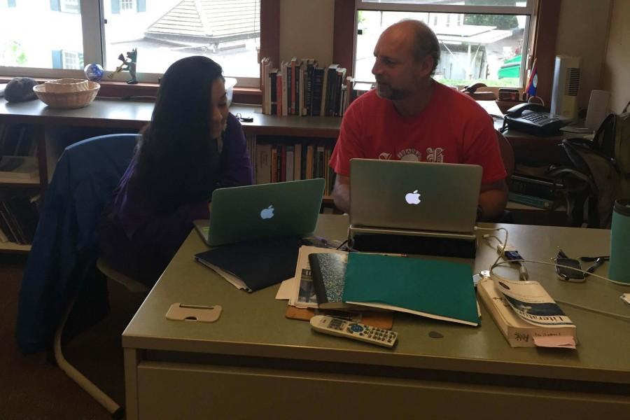 Seabury Hall English teacher Alan Hodara works with senior Kyleigh Manuel-Sagon on an essay.