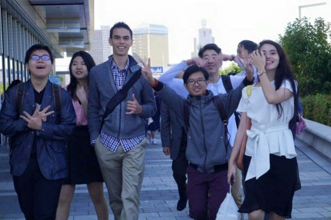 Birnie and his fellow youth ambassadors at the base of the tallest building in Tokyo, Japan.