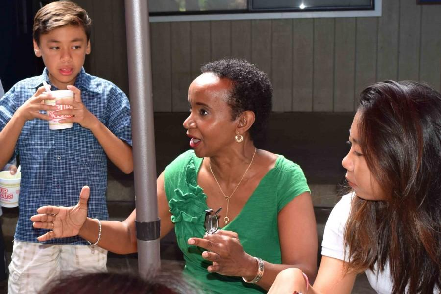 Seabury Hall's new head of school interacts with middle school students.