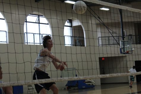 Junior Ian Roth returns the ball during a recent practice.