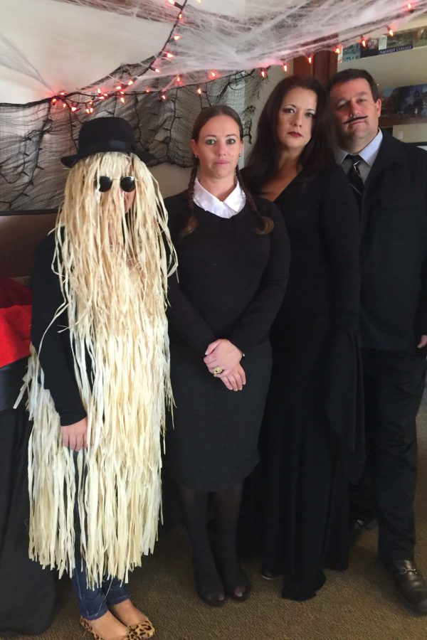 Seabury Hall's College Counseling Office greets students as the Adams Family on Halloween.