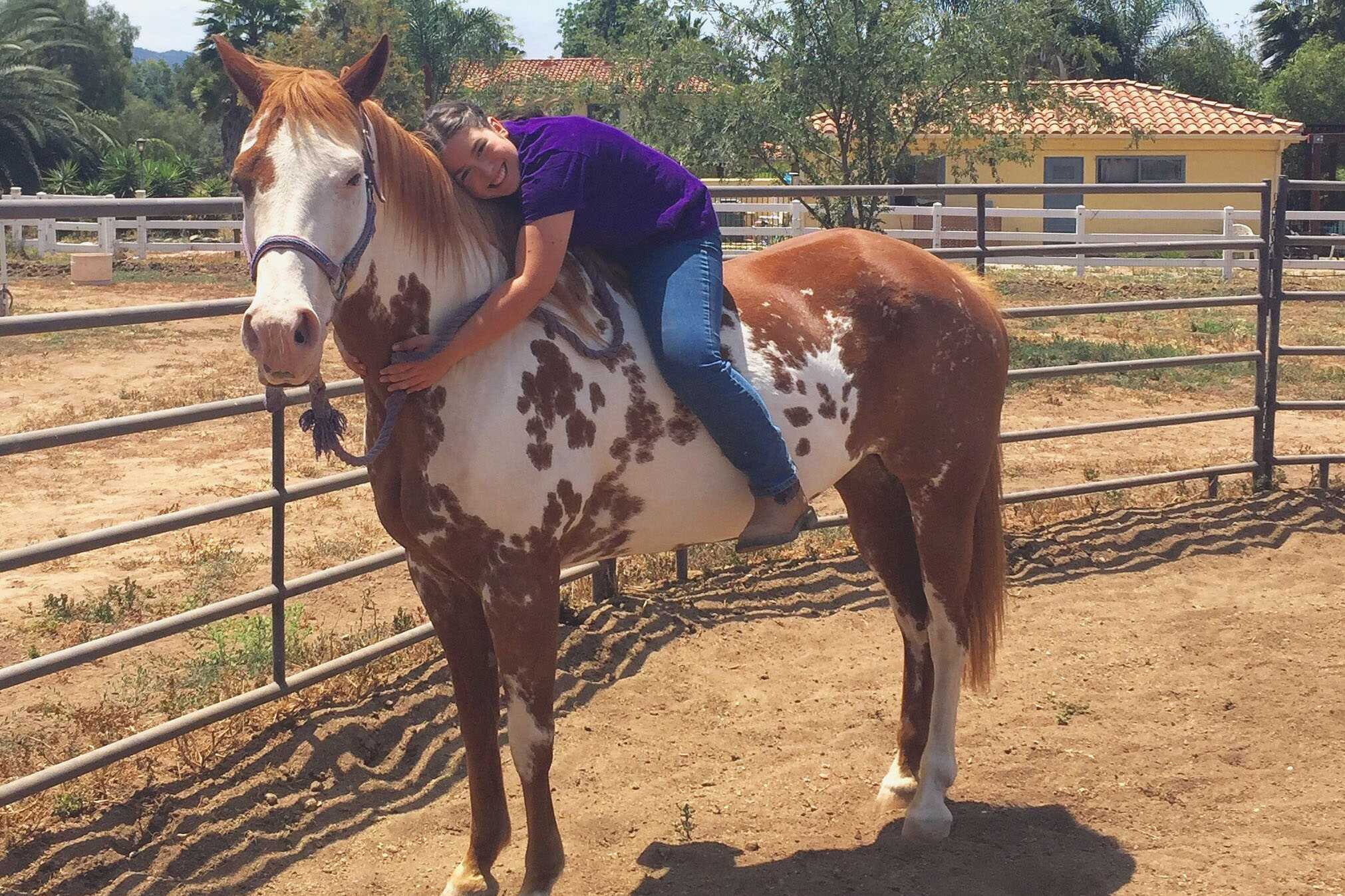 Seabury Hall senior Maryann Shilo treasures the time she spends with horses, especially with Pearl, her mother's Paint horse.