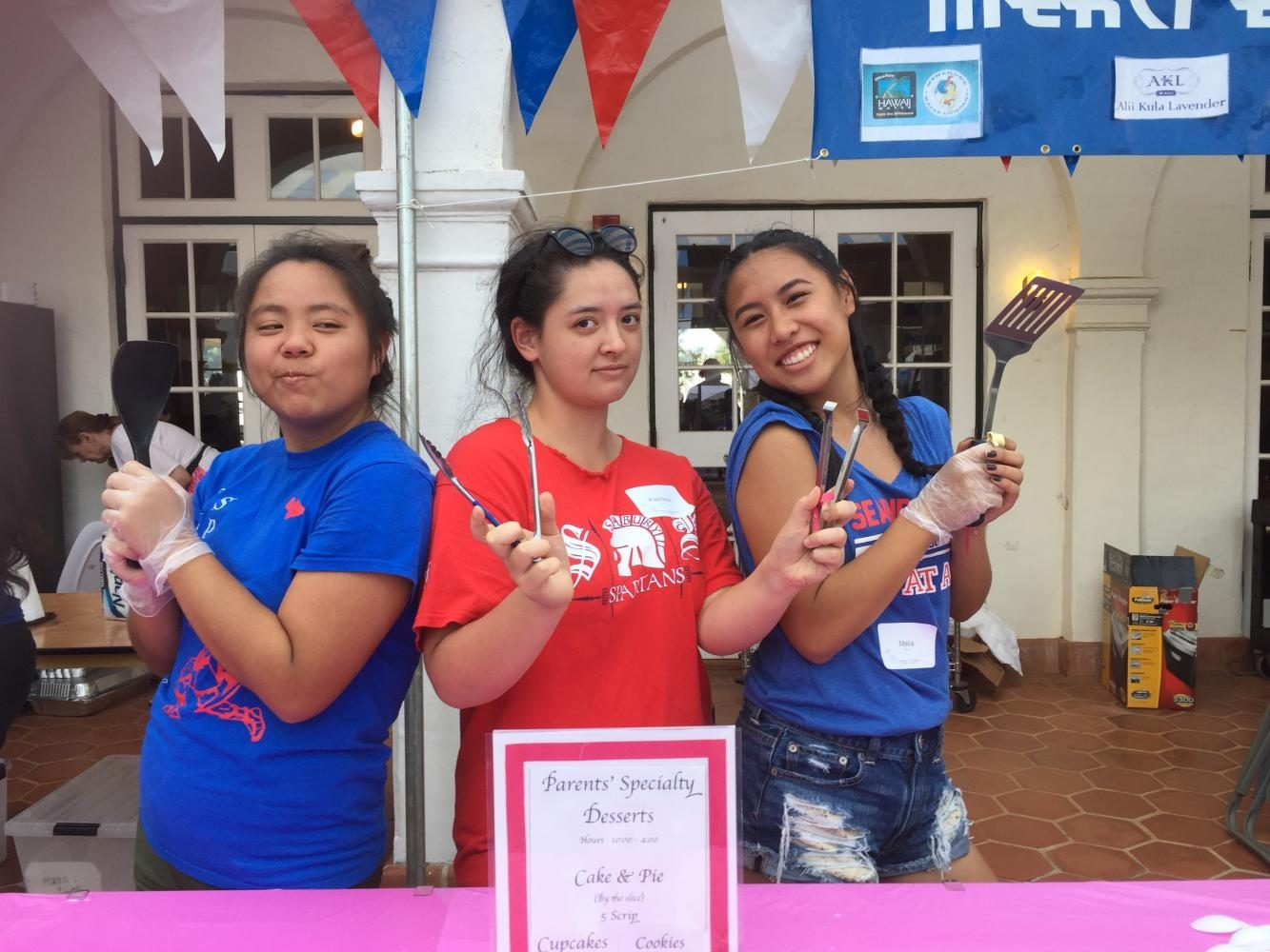 Senior Angela Yasutomi, junior Hiwa Grieg, and junior Melia Fong serve up sweets at La Patisserie.